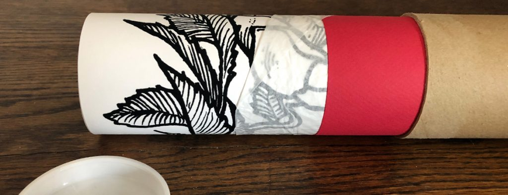 Photograph of artwork packaged in sturdy cardboard mailing tube